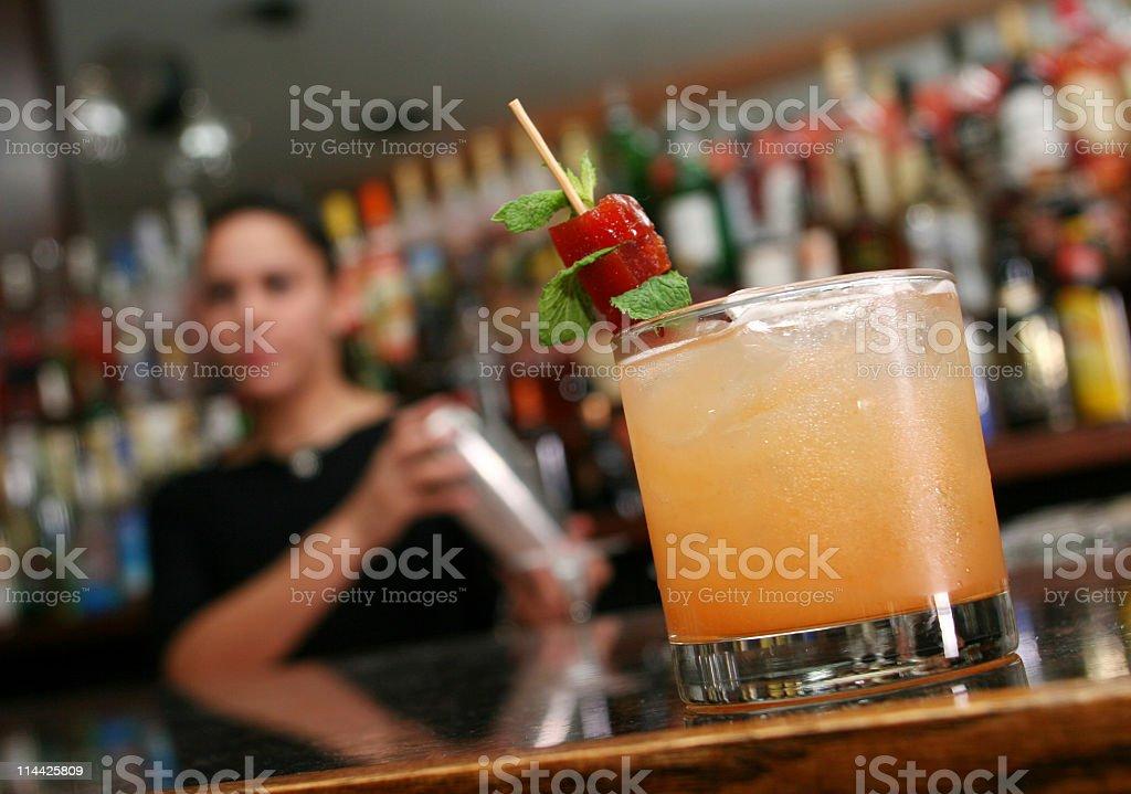 Barman preparing a cocktail royalty-free stock photo