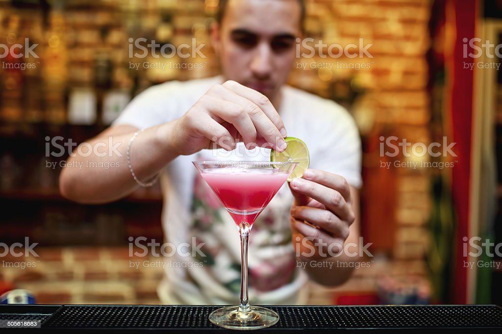 barman preparing cosmopolitan alcoholic cocktail drink at bar stock photo