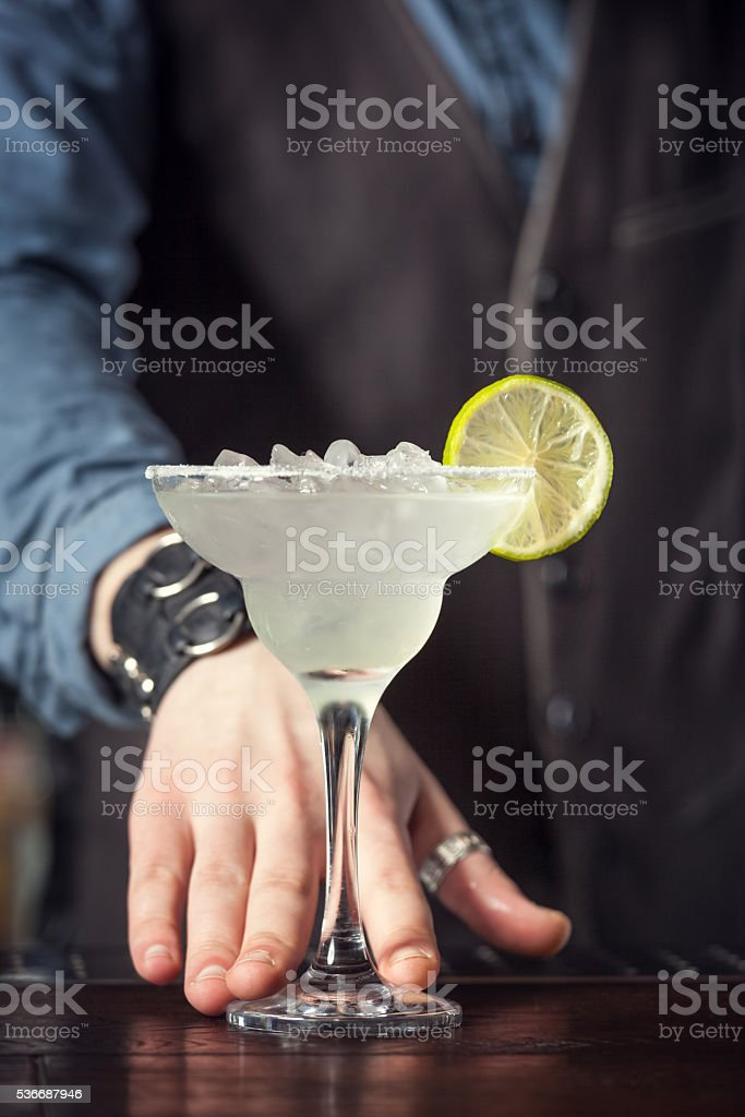 Barman serving cocktail. stock photo