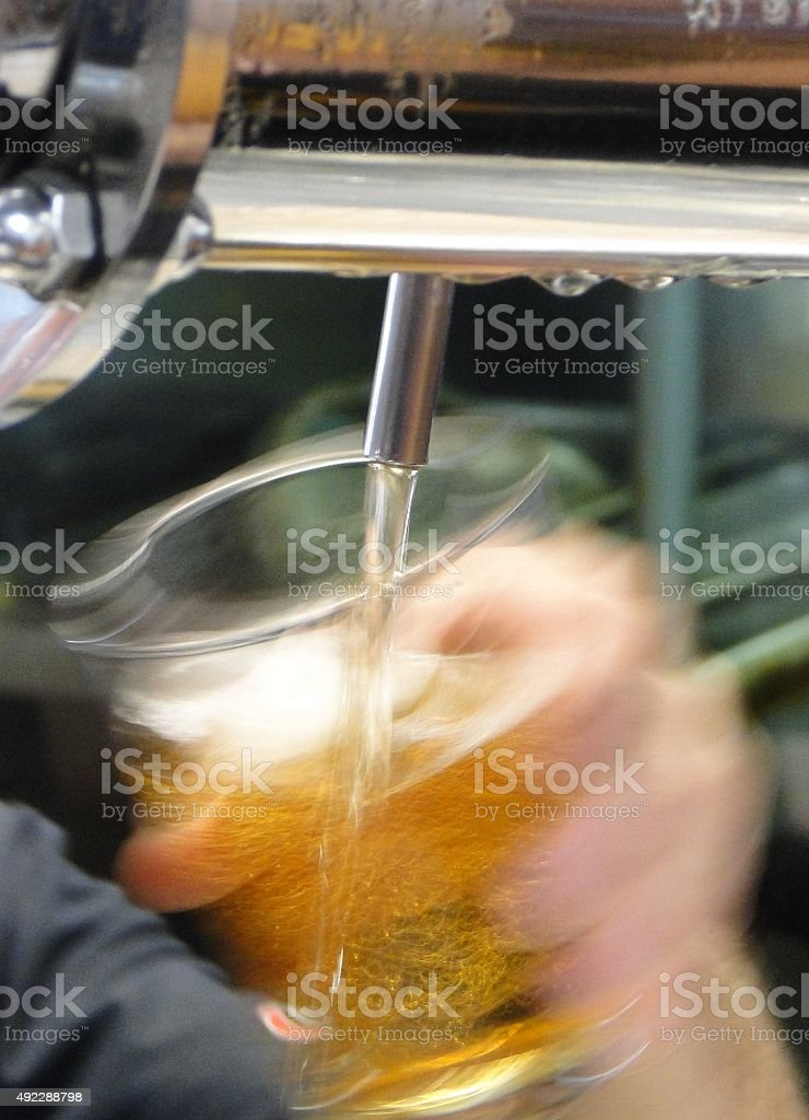 Barman taking beer stock photo