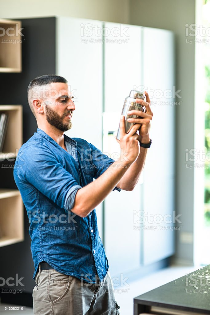 barman with the shaker stock photo