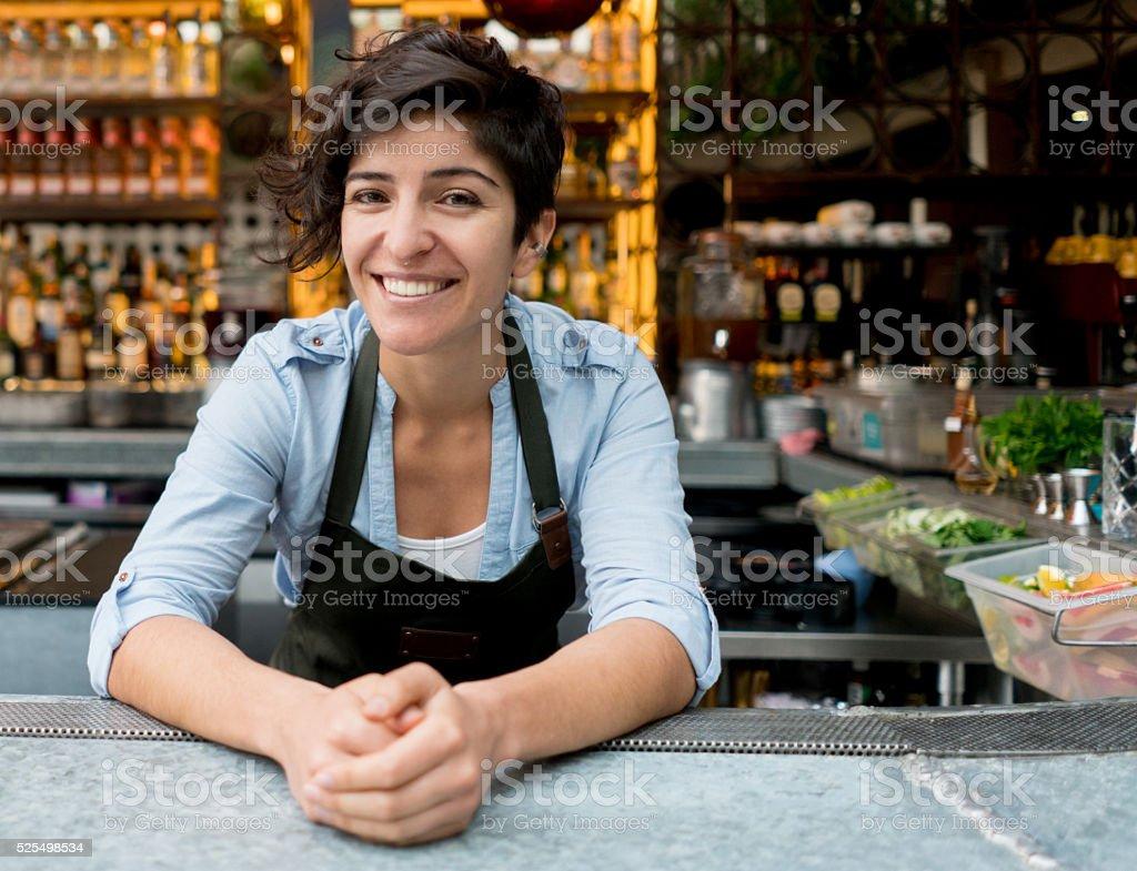 Barman working at a bar stock photo