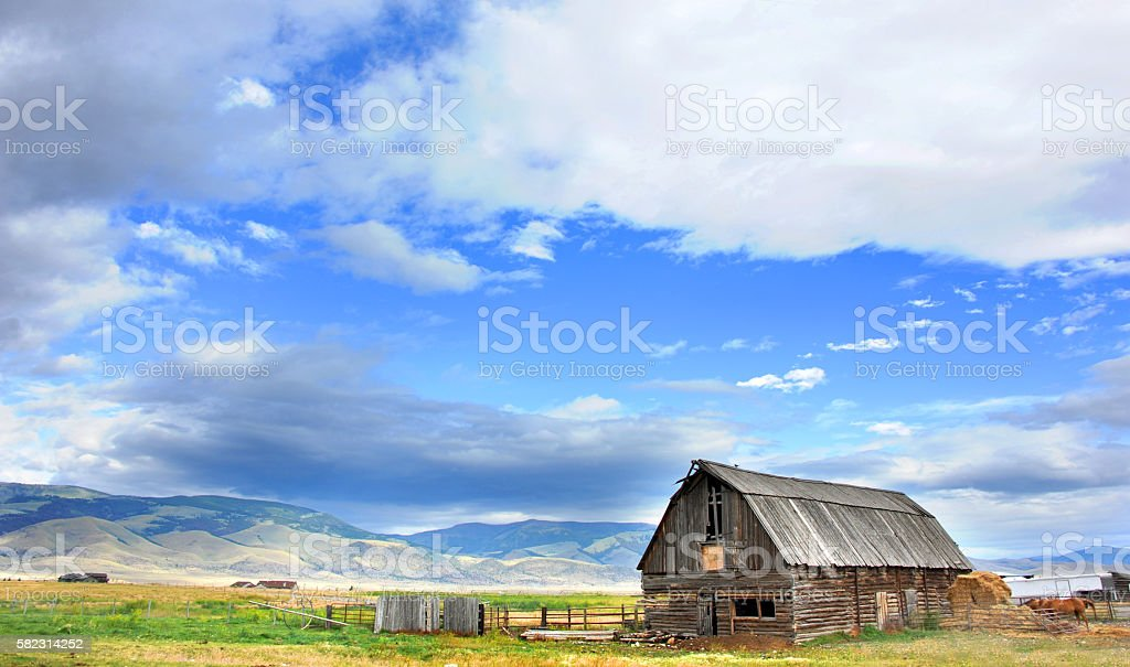 Barn and Gallatin Mountains stock photo