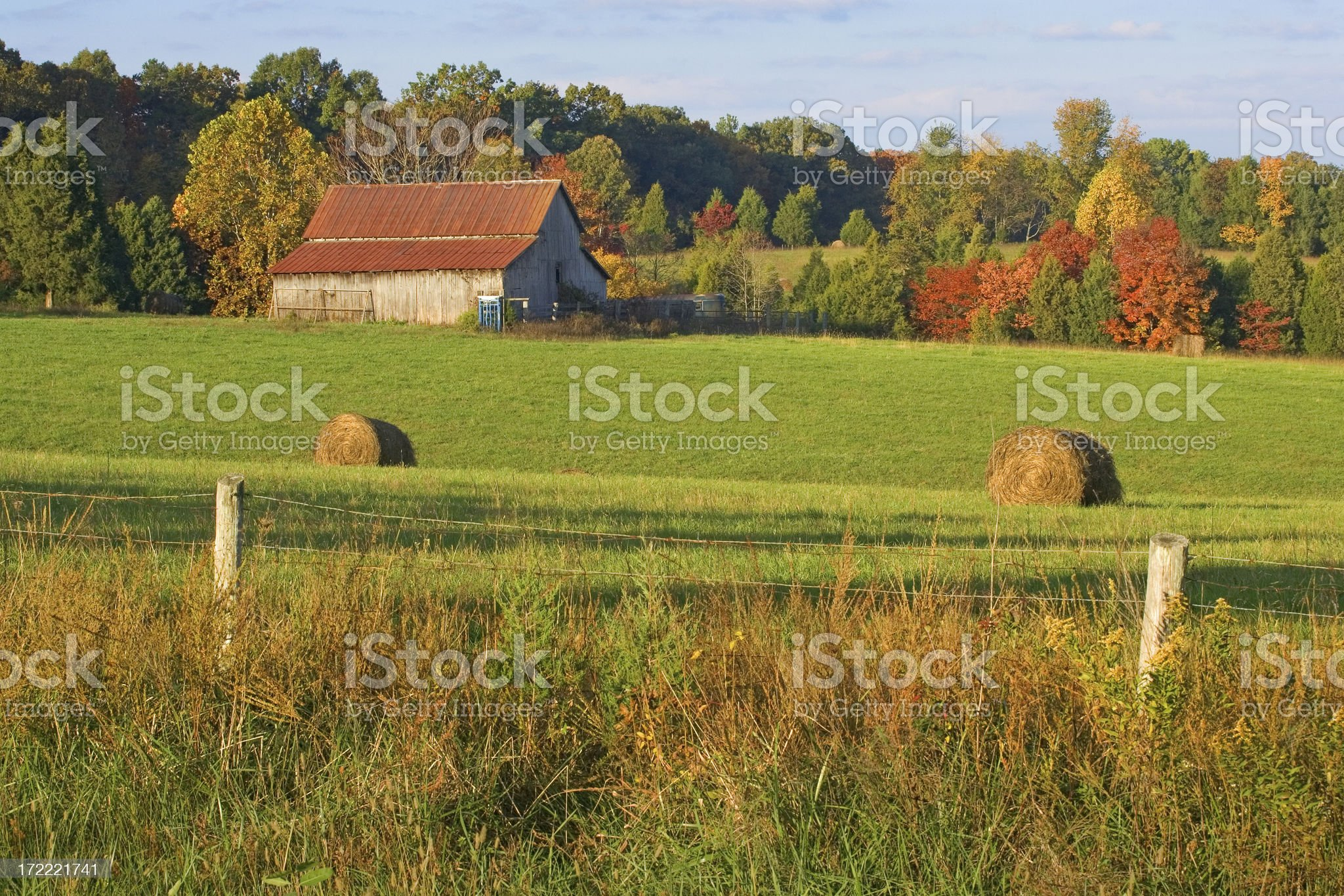 Barn and Hay Field in Autumn royalty-free stock photo