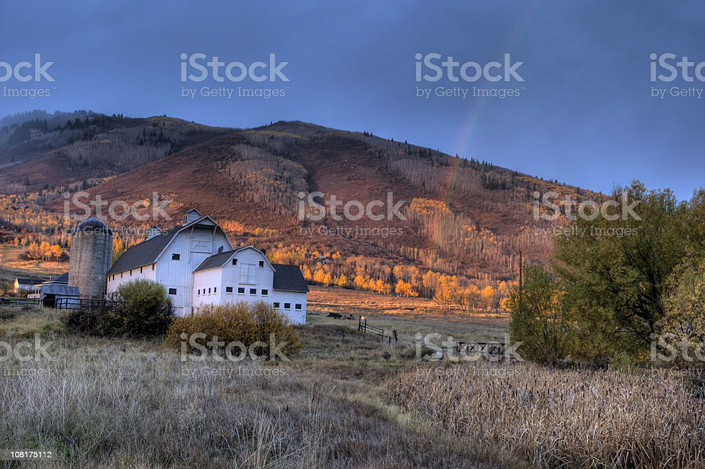 Barn and Rainbow stock photo