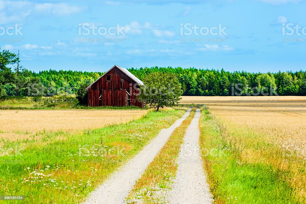 Barn by the road stock photo