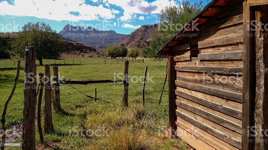 barn Grafton Ghost Town pastures below Smithsonian Butte Rockville Utah stock photo