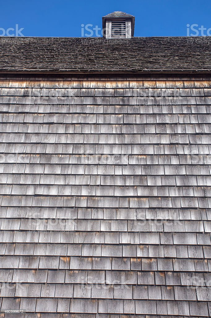 barn with cupola covered with weathered wood shingles stock photo