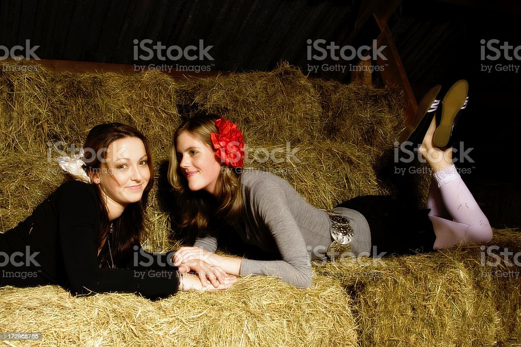 Barn with two girls stock photo
