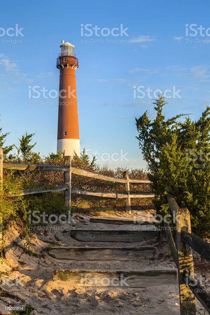 Barnegat Lighthouse in Early Morning Sunshine With Blue Sky stock photo