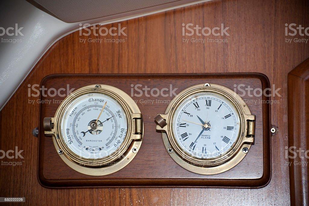 Barometer and clock stock photo