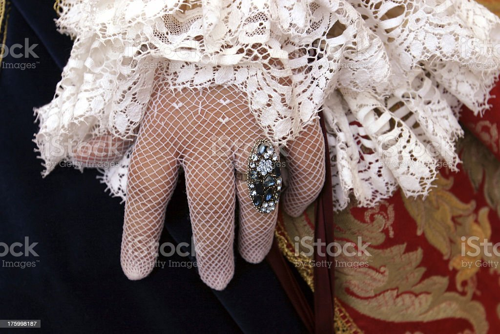 Baroque hand with net gloves and blue ring royalty-free stock photo