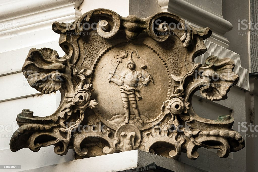 Baroque stone cartouche on corner of house in Bratislava stock photo