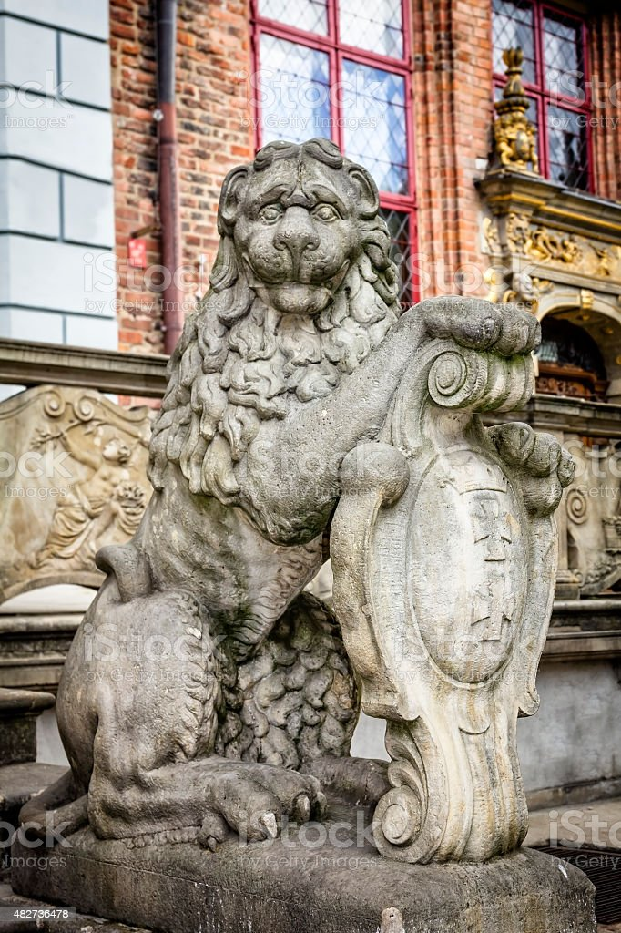 Baroque stone Lion with coat of arms stock photo