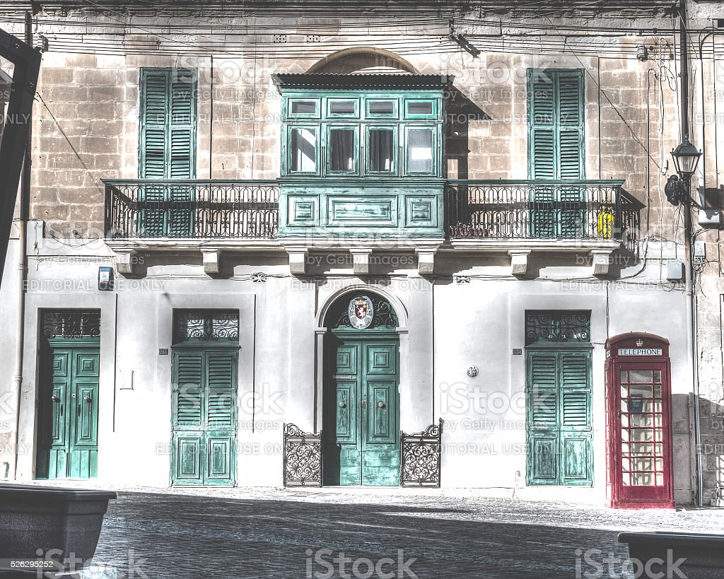 Baroque style building with green shutter stock photo