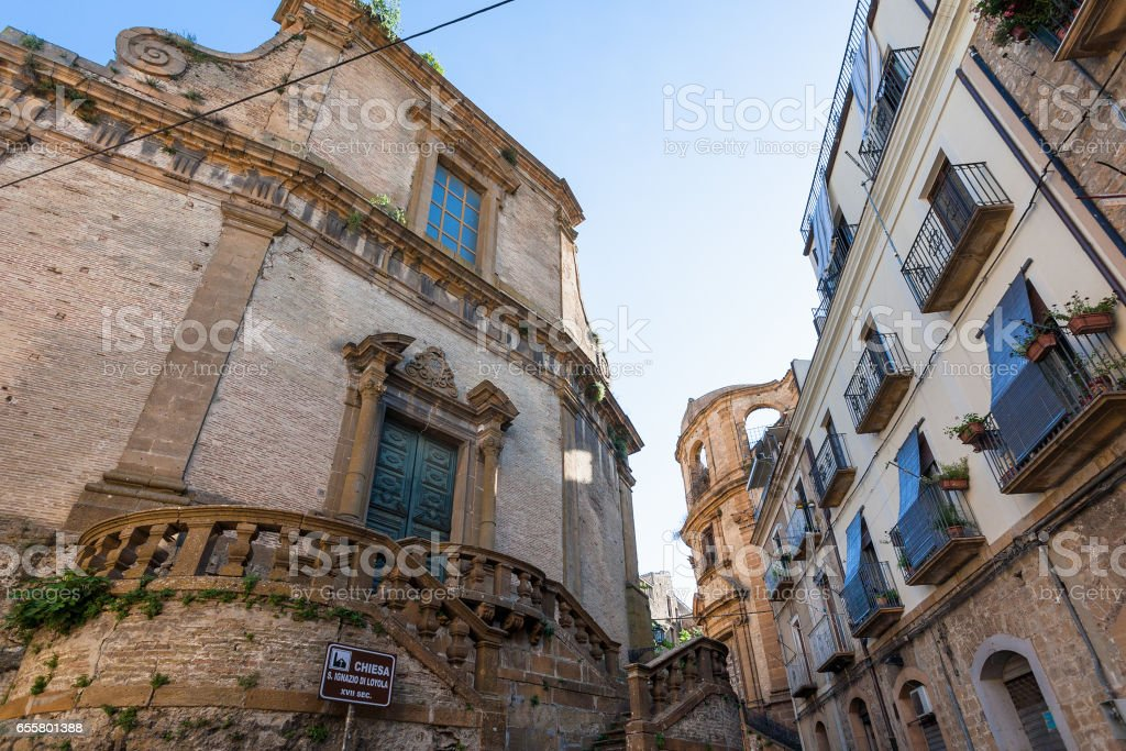 baroque style church and urban houses stock photo