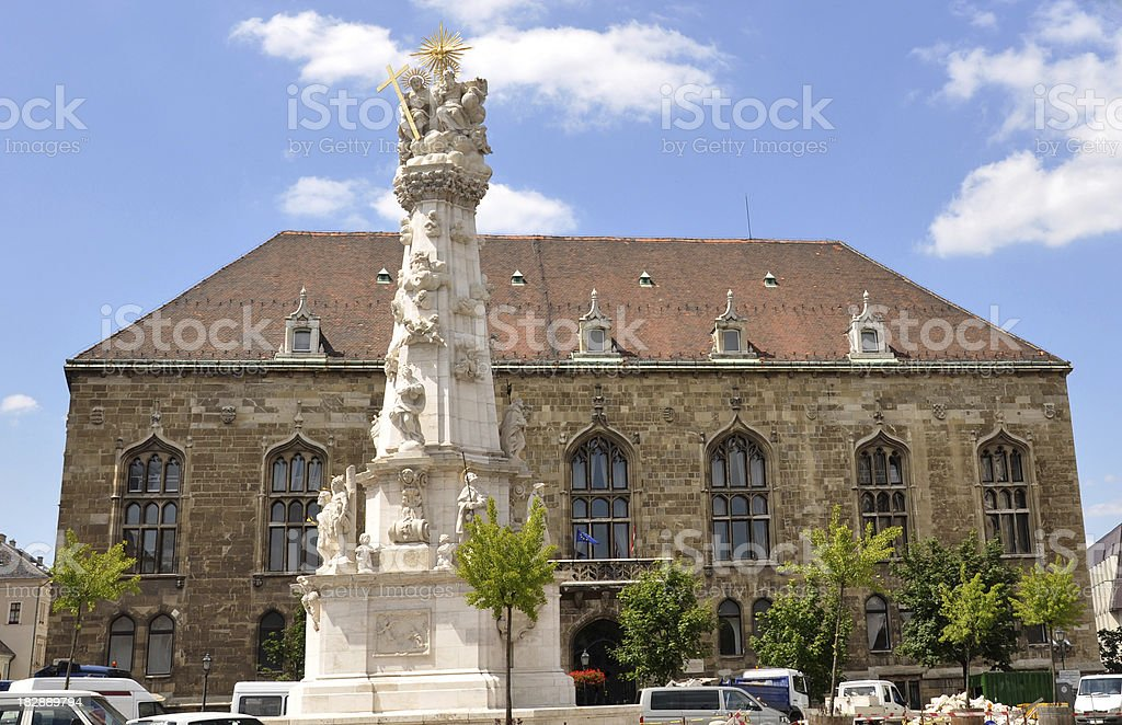 Baroque Trinity Statue and an old building, Budapest, Hungary stock photo