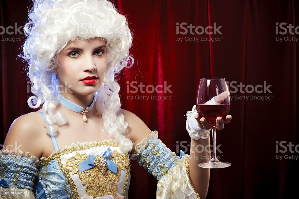 Baroque woman with red wine glass royalty-free stock photo