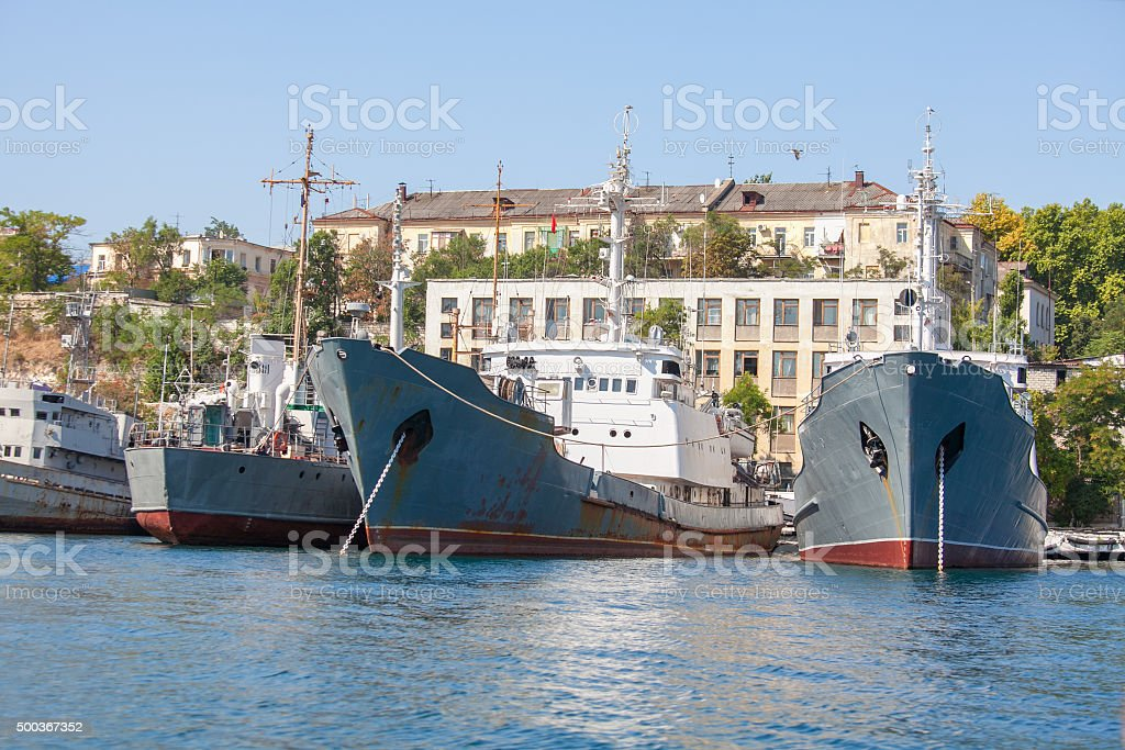 barracks and old warships stock photo