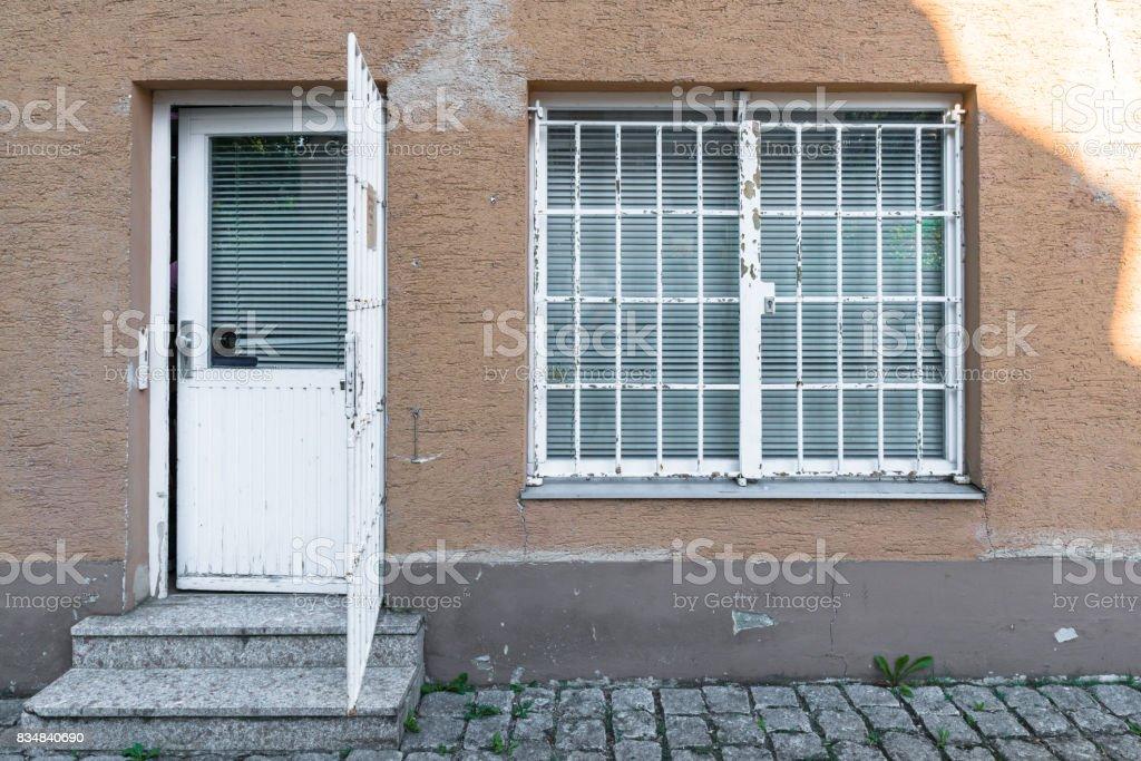 Barred entrance door and window stock photo