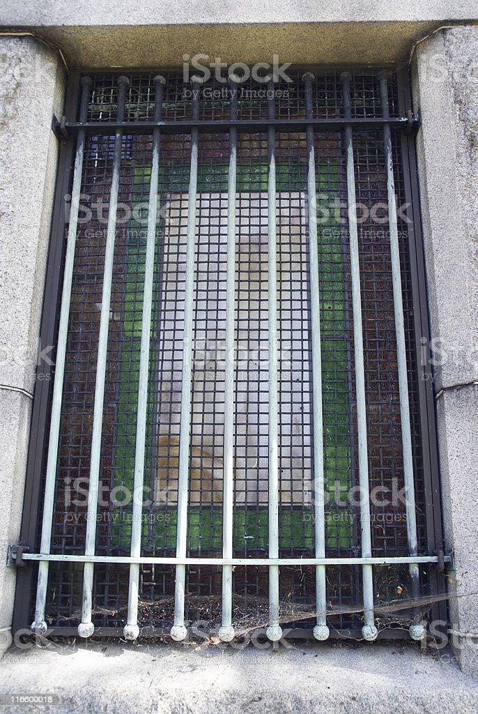 Barred Window on Graveyard Vault royalty-free stock photo
