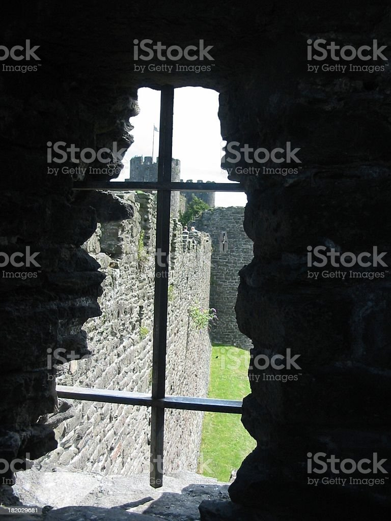 Barred window on upper floor of castle in UK. royalty-free stock photo