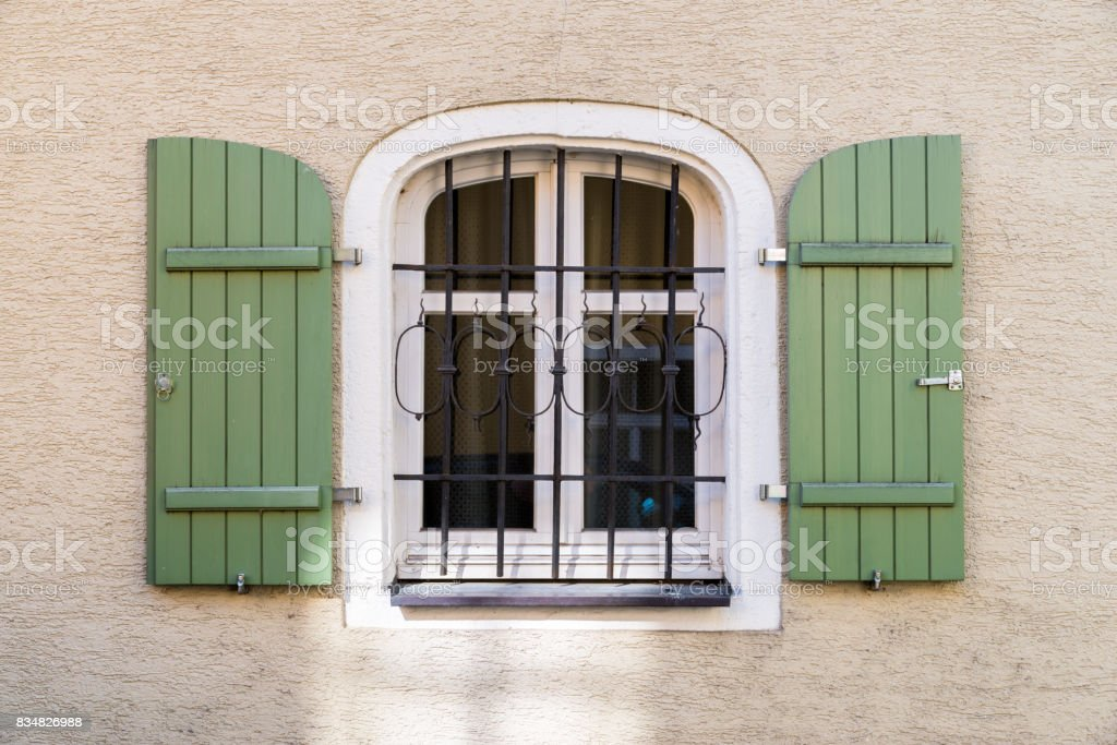 Barred window with shutter stock photo
