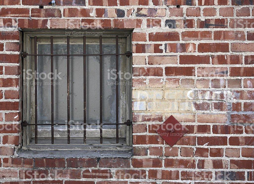 Barred windows in high crime area stock photo