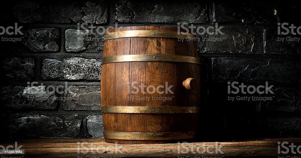 Barrel and brick wall stock photo