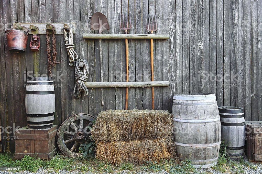 barrel bale and pitchfork in old barn stock photo