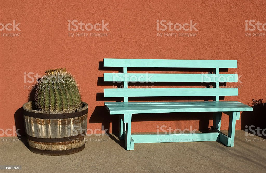 Barrel Cactus and turquoise bench royalty-free stock photo