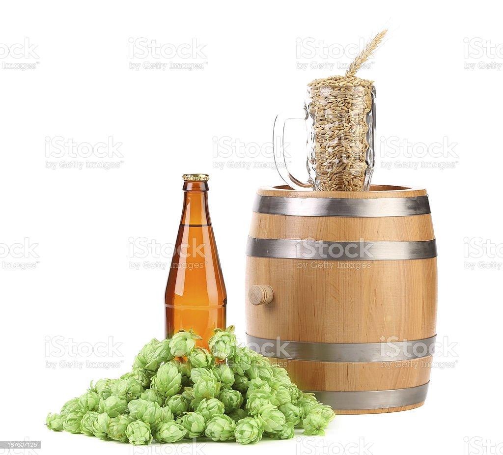 Barrel mug with barley hop and bottle of beer. royalty-free stock photo