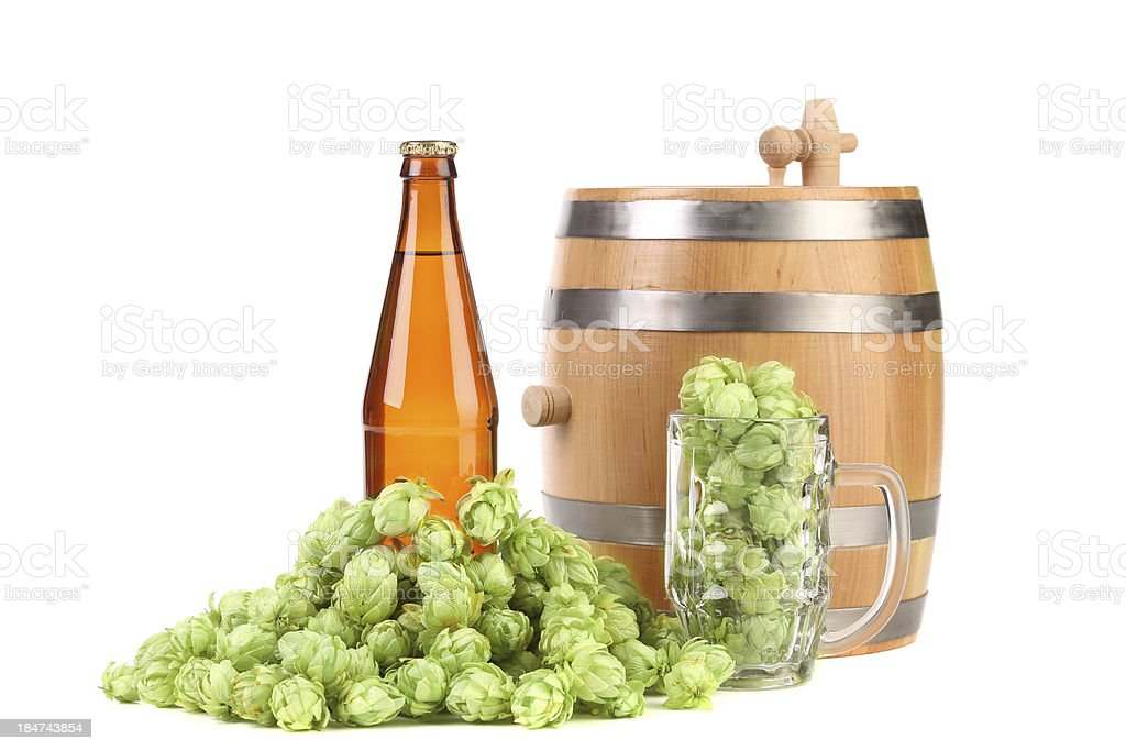 Barrel mug with hop and bottle of beer. royalty-free stock photo
