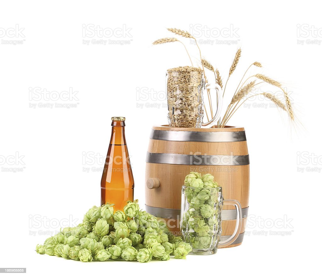 Barrel mug with hops and bottle of beer. royalty-free stock photo