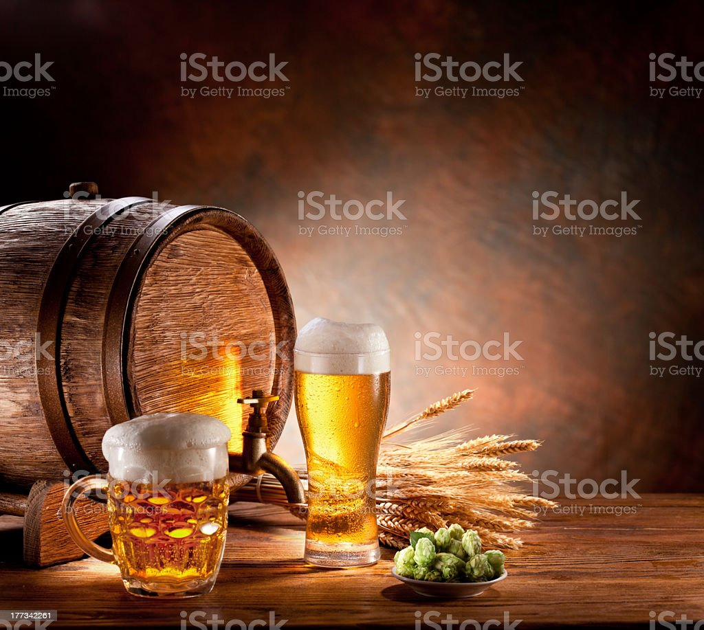 A barrel of beer and full glasses on a wooden table royalty-free stock photo
