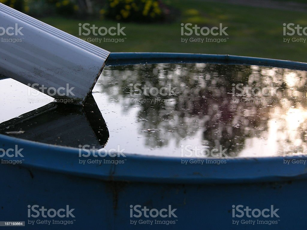 Barrel of water from drain pipe stock photo