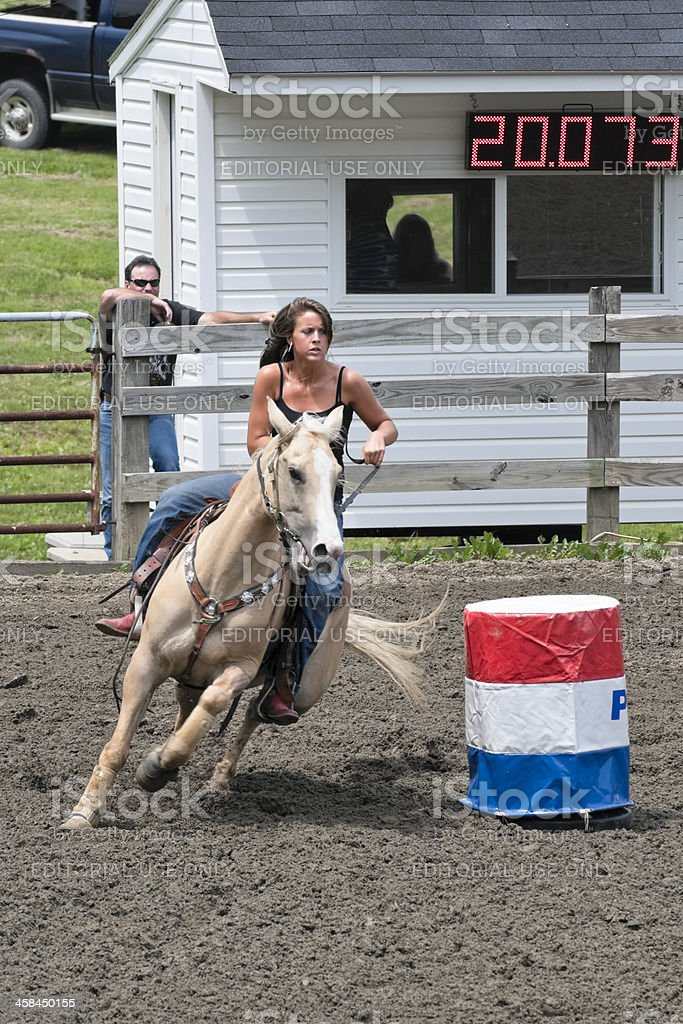 Barrel Racing with Horse and Rider Competing stock photo