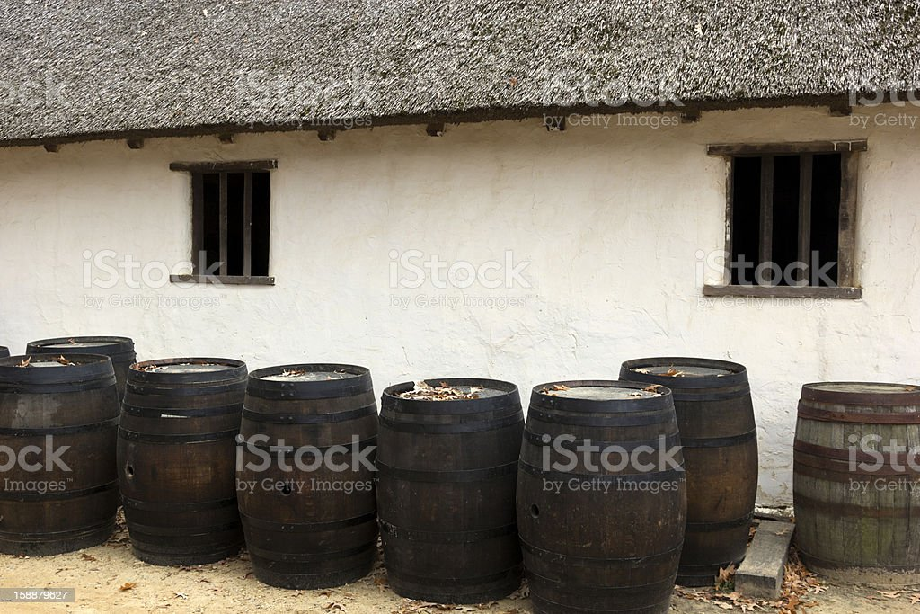 Barrels by an old house royalty-free stock photo