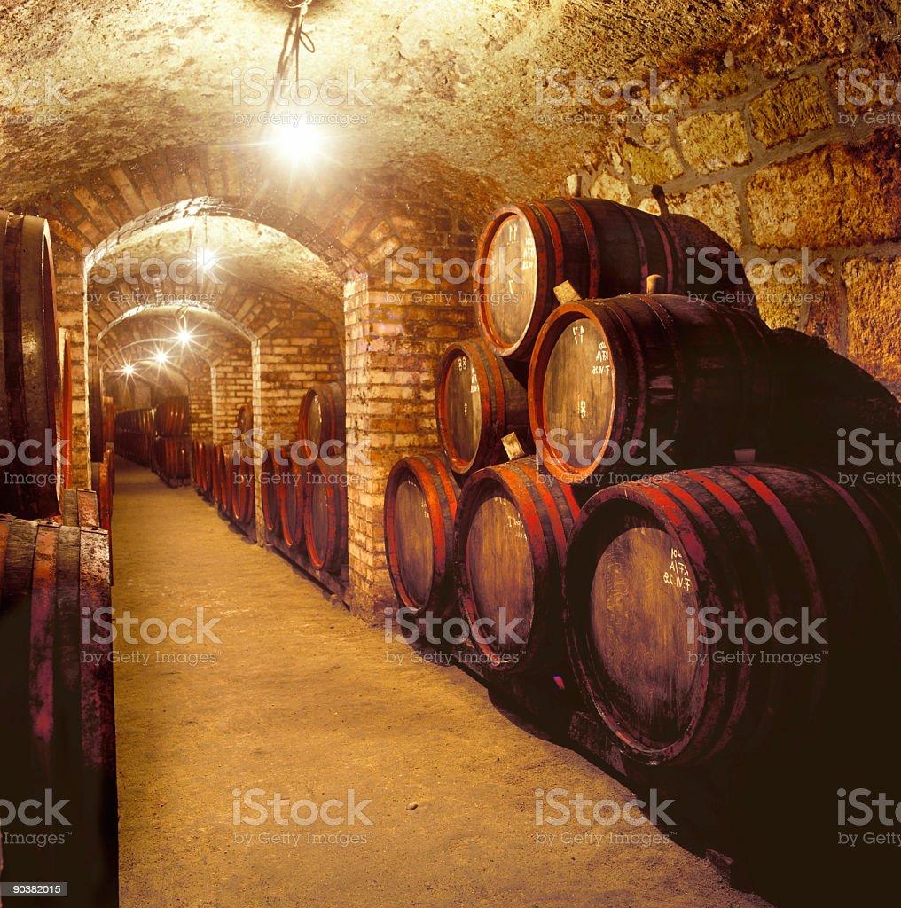 Barrels in a wine cellar stock photo