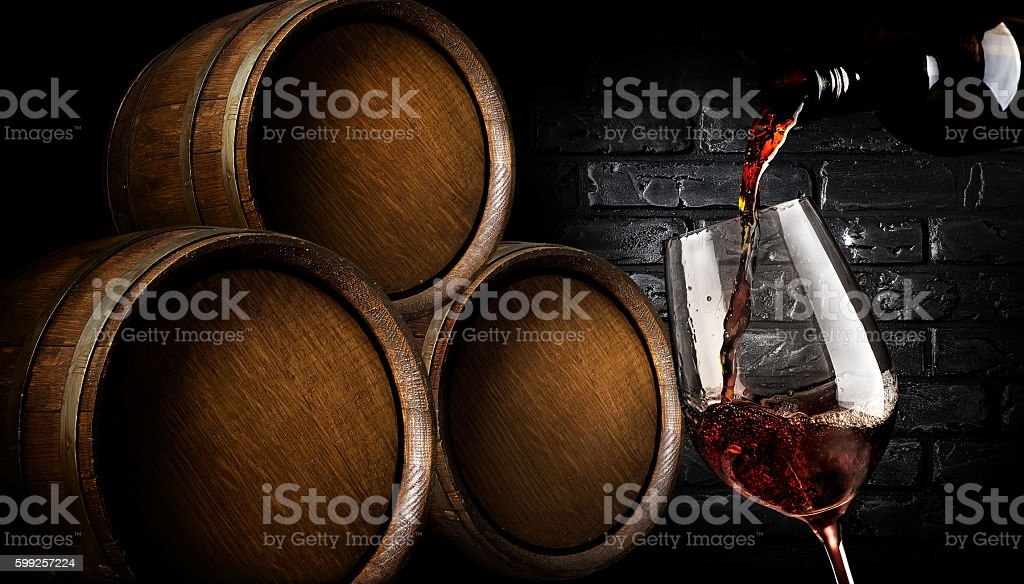 Barrels with wine stock photo