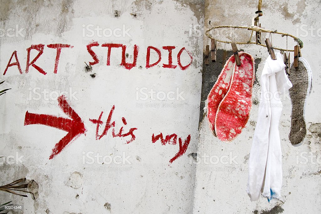 Barren art studio with clothes hanger and wall graffiti stock photo