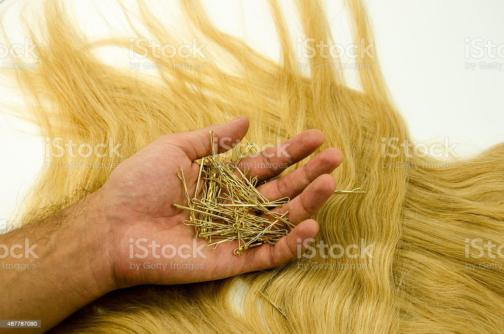 Barrettes in her hand stock photo