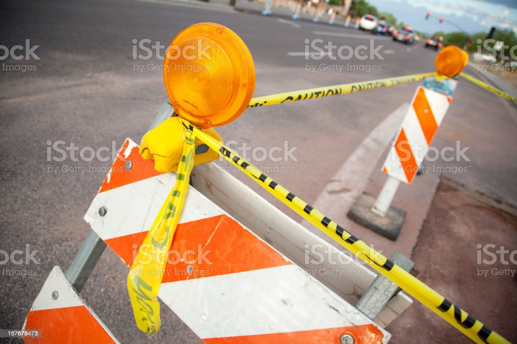 Barricades and Yellow Caution Tape for Road Construction stock photo