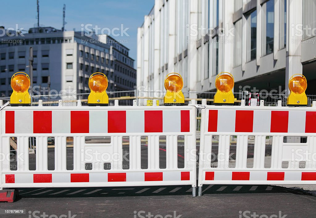 barricades with row of yellow traffic warning lamps stock photo