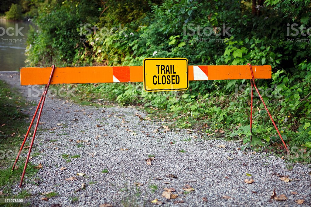 Barrier and trail closed sign due to flooding. royalty-free stock photo