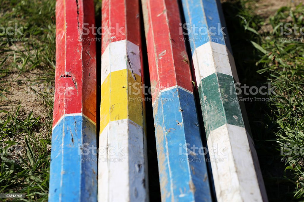 Barriers on the ground for jumping horses as a background stock photo