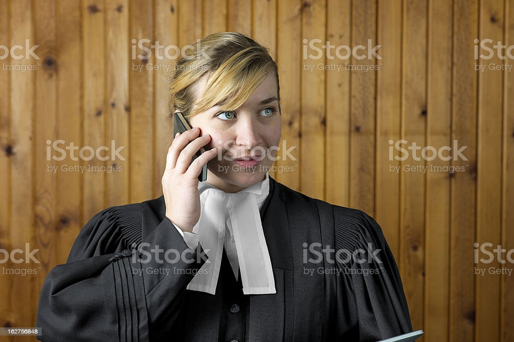 Barrister or Lawyer in Traditional Robes on Her Mobile Phone royalty-free stock photo