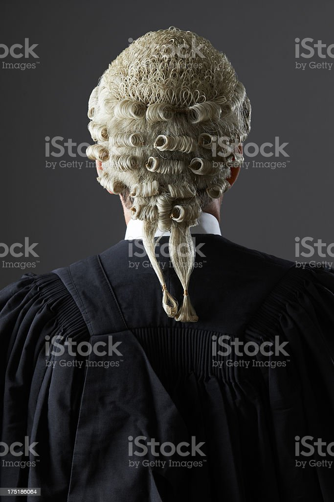 Barrister Wearing Wig And Gown From Behind stock photo