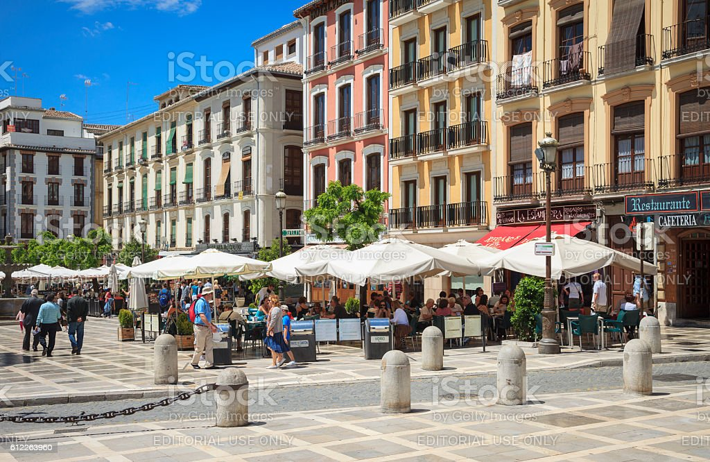 Bars and restaurants in a plaza in Granada, Spain stock photo