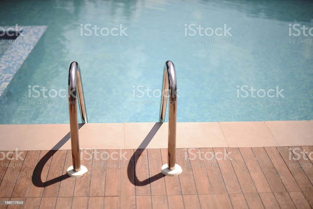 Bars ladder in the swimming pool royalty-free stock photo